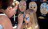 Lylian Vaughan, 8, has her face painted by Ann Dunlap of Mom' Faces.<br /> Bob Raines--Montgomery Media
