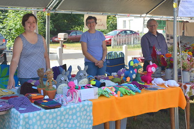 Caity, Bobbi, and Bob smiled big for the camera!  Bobbi and Bob did a great job keeping things going at the Canterbury Historical Society booth and Caity sold a lot of her great crocheted creations to a lot of very happy customers!
