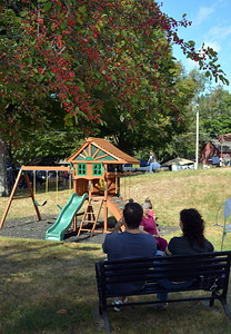 Lots of kids had a good time on the Canterbury First Congregational Church's playscape while their parents enjoyed a bit of shade.