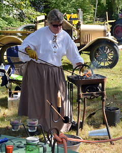 Lynne Krug tends to her own forge.