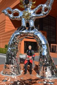 Jan Jenson under statute in front of Bechler Art Museum