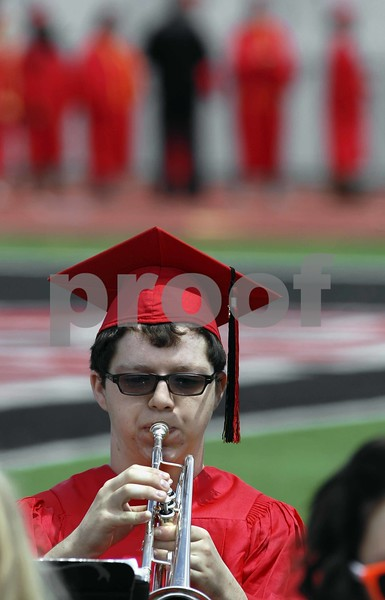 -Messenger photo by Hans Madsen<br /> <br /> With his classmates lined up behind him, Nick Swanson plays some of his last notes on his trumpet with the band Sunday afternoon at the 2015 Fort Dodge Senior High Graduation Commencement at Dodger Stadium.