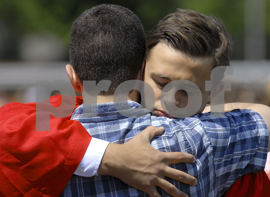 -Messenger photo by Hans Madsen<br /> <br /> Graduate Ben Ahlers gets a hug from his dad, Paul Ahlers, of Fort Dodge, following the 2015 Fort Dodge Senior High Graduation Commencement at Dodger Stadium. 209 students graduated Sunday.