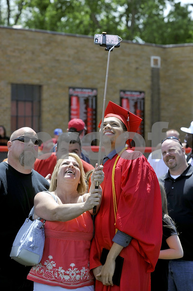 -Messenger photo by Hans Madsen<br /> <br /> Graduate Jordan Gallegly poses for a photo with his grandmother, Malyn Vinnece, of Fort Dodge, following the 2015 Fort Dodge Senior High Graduation Commencement at Dodger Stadium Sunday afternoon.
