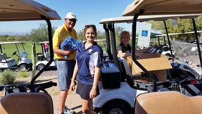 John, Frieda and Pam distribute golf shirts