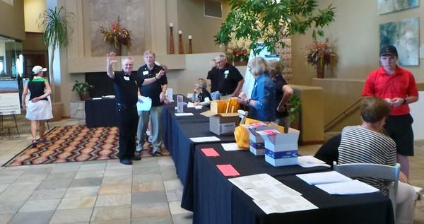Registration volunteers prepare for the golfers