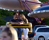 Bob Raines--Montgomery Media<br /> A couple spend time talking as they wait for the Paratrooper ride to fill up at the Harleysville Fair May 22, 2015.