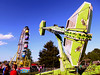 Bob Raines--Montgomery Media<br /> Riders on this centrifical space-ship style device, right, could often be heard to scream, unlike the tamer ferris wheel in the background at the Harleysville Fair May 22, 2015.