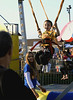 Bob Raines--Montgomery Media<br /> Scott Alcott has fun bouncing on the Gravity Storm, although he is so light the attendant must occasionally stretchthe bungee cords to keep him going at the Harleysville Fair May 22, 2015.