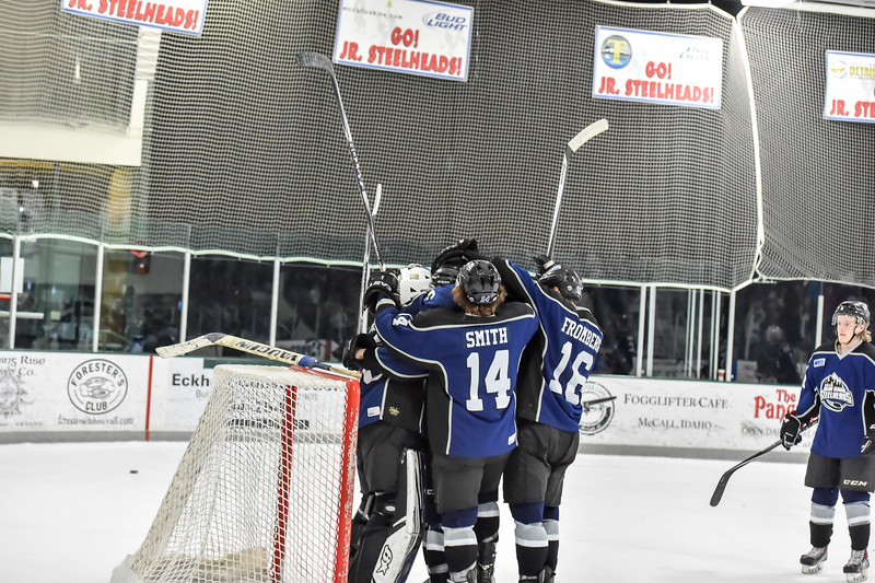Junior Steelheads Tyler Hough (35), Jack York (4), Kyle Smith (14), and Phil Fromberger (16) celebrate the win at the final buzzer at Saturday's game.
