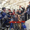 Junior Steelheads Kyle Ten Eyck (25) first bumps some Steelhead fans as he heads into the locker room after Saturday's win.