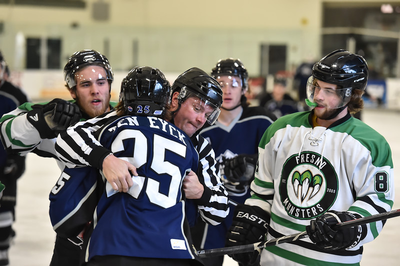 A Monster player (8, not on the roster) throws another punch at Jr. Steelheads Kyle TenEyck (25) while the referee works at breaking up the fight during Saturday's game in McCall.