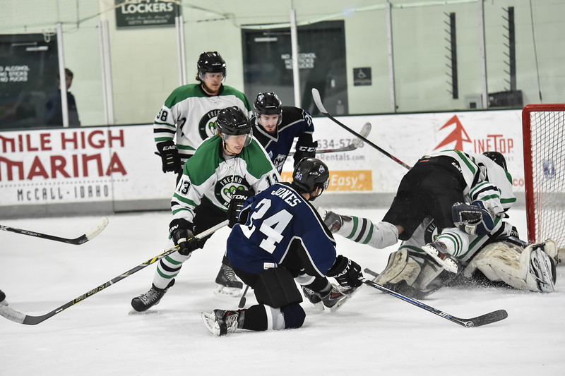 Junior Steelheads Dimitris Jones (24) attempts a goal through a pileup of Fresno Monster players during Saturday's game.