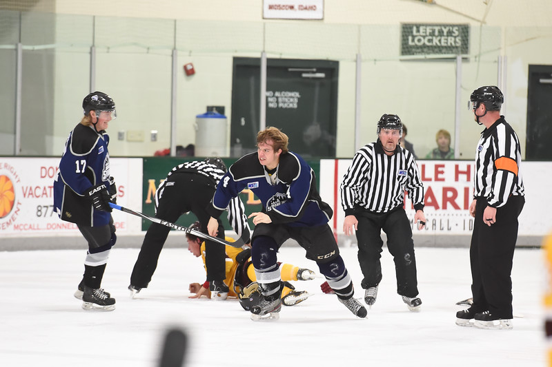 A triumphantly jubilant Jack York (4) from the Junior Steelheads heads to the penalty box after pounding Wolverines player Nathan Luznar-Purdy (24) into the ice during Friday's one sided game.