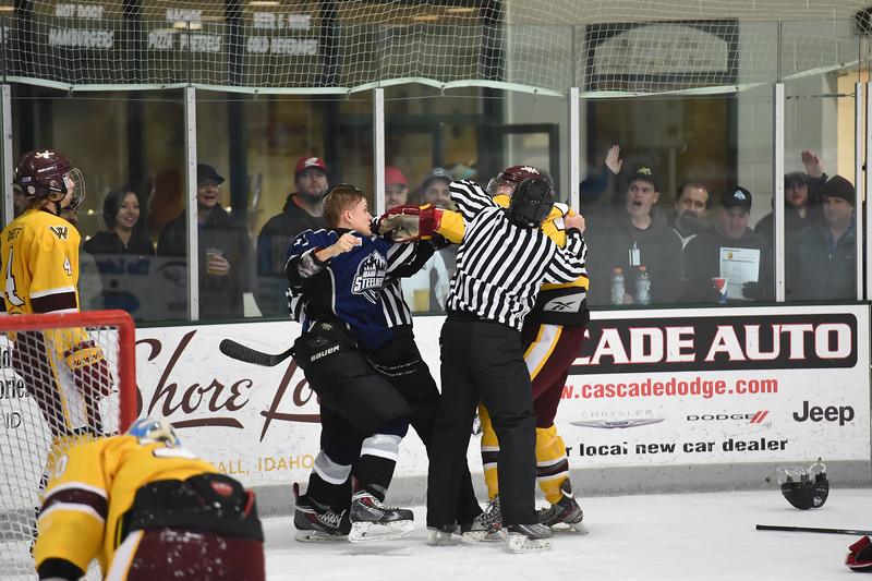 With the Jr. Steelheads leading 8 - 0 late in the 3rd period, the tensions were high and the gloves came off.  Jr. Steelheads Oleg Losev (11) and Wolverines Bryan Palmer (17) exchanged blows to each other, and knocking down referees.  Both players got expelled from the game.