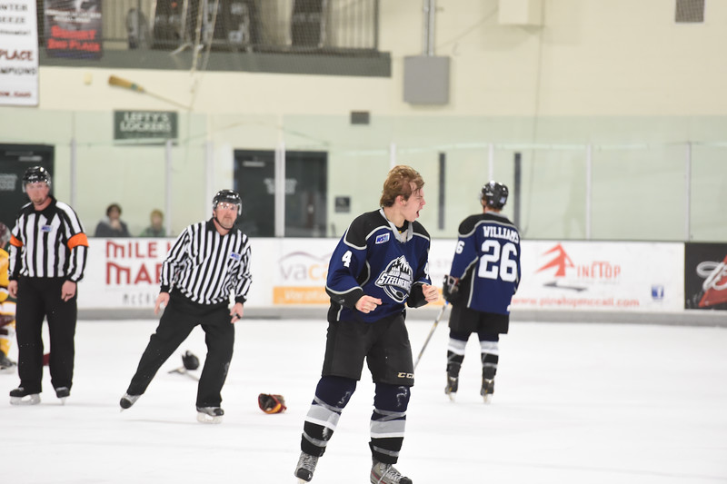 A bloody knuckled Jr. Steelheads Jack York (4) cheers to his teammate in the bench as he heads into the penally box after a heated gloves off fight during Friday's game in McCall.