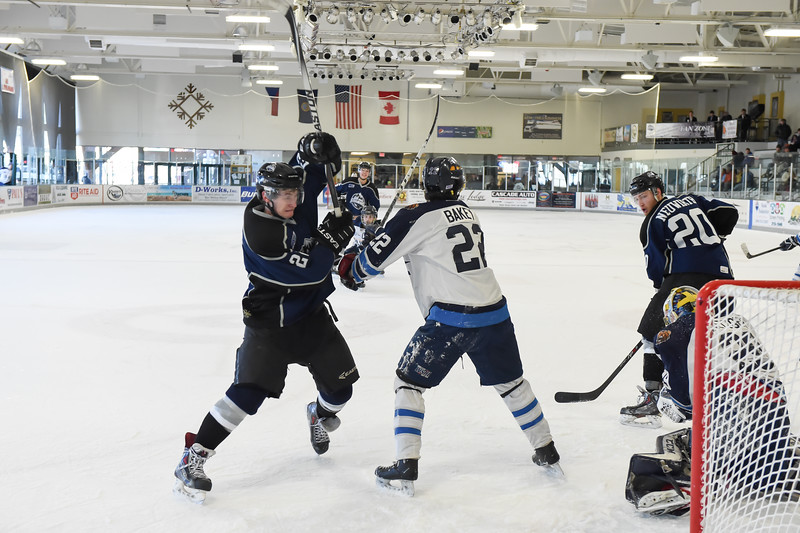 It was almost a gloves off situation with Junior Steelheads Hunter Lester (22) and Lake Tahoe Blue's Nicholas Bakey (22) late in the 2nd period of Sunday's game in McCall.