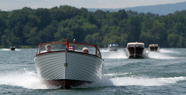 Alan and Faye Smith maneuver their 1957 Sea Skiff ahead of the trailing boats during a tour of Lake Chatuge on Friday afternoon.