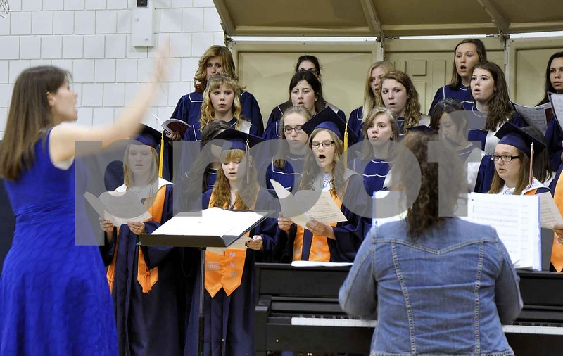 -Messenger photo by Joe Sutter<br /> <br /> In the front row seniors Elsa Martens, left, Rachel Nickles and Kathryn Keller sing with the MNW choir for the last time, directed by Nichole Miller and accompanied by Shelly Bottorf.