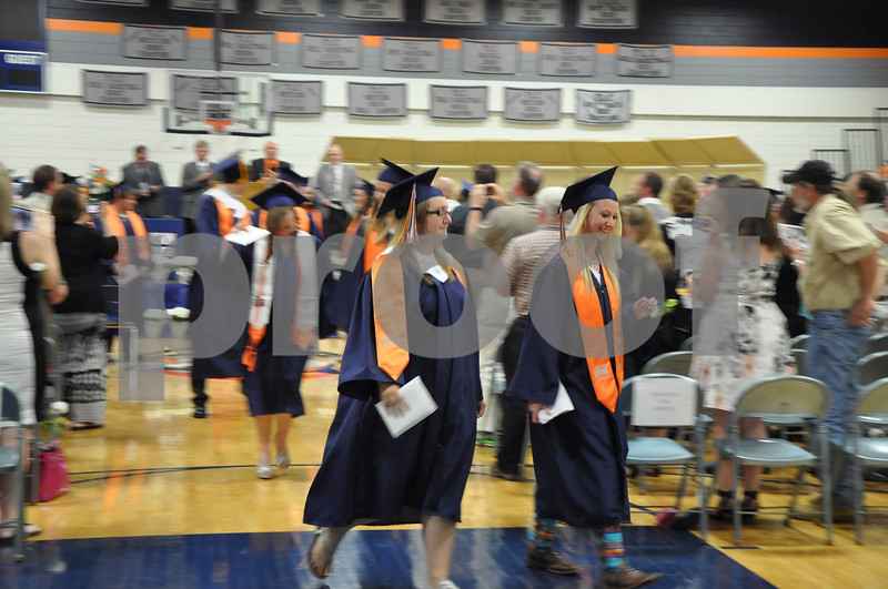 -Messenger photo by Joe Sutter<br /> <br /> Bailey Thoel, left, and MacKenzie Nelson file out in the procession of new graduates after the MNW commencement ceremony Sunday.