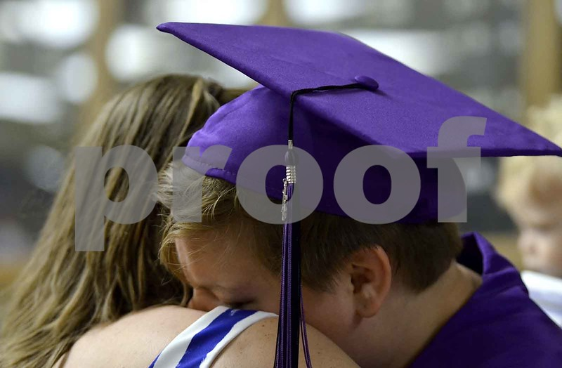 -Messenger photo by Britt Kudla<br /> Britney Crawford of South Central Calhoun cries on her mother shoulder before South Central Calhoun graduration on Sunday