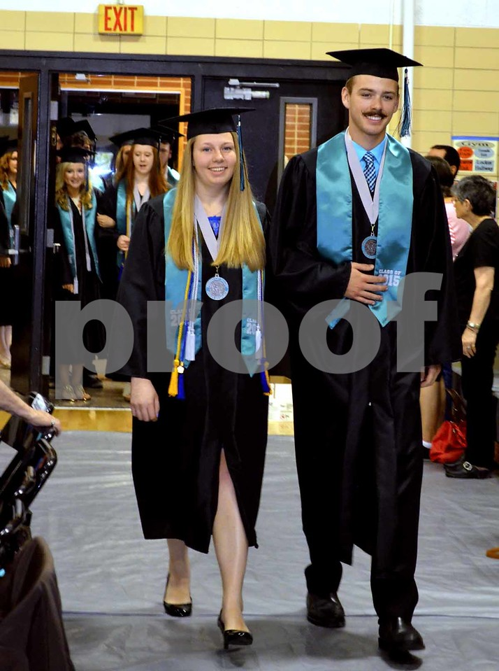 -Messenger photo by Brandon L. Summers<br /> <br /> Katie Walrod, left, and Skylar Warehime, lead Southeast Valley's first ever graduating class into the gymnasium.
