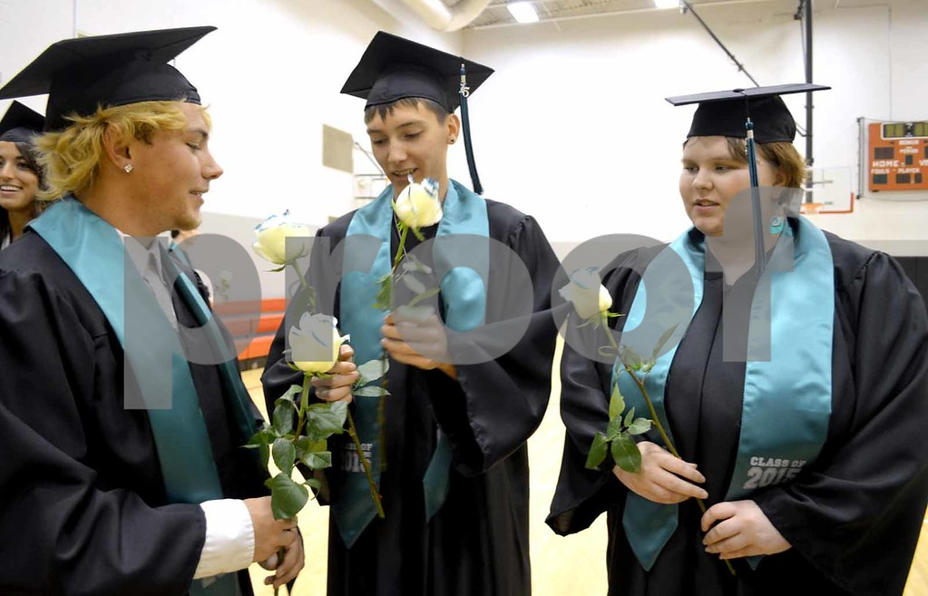 -Messenger photo by Brandon L. Summers<br /> <br /> After receiving their diplomas, 2015 Southeast Valley graduates Dustin Gurnett, left, Jalen Fuss and Alexus Dow, received their teal-tipped white roses.