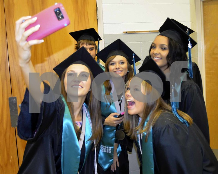 -Messenger photo by Brandon L. Summers<br /> <br /> Southeast Valley graduates Kennedy Gallentine, left, and Miranda Engeldinger, take a picture together with their friends before graduating Sunday.