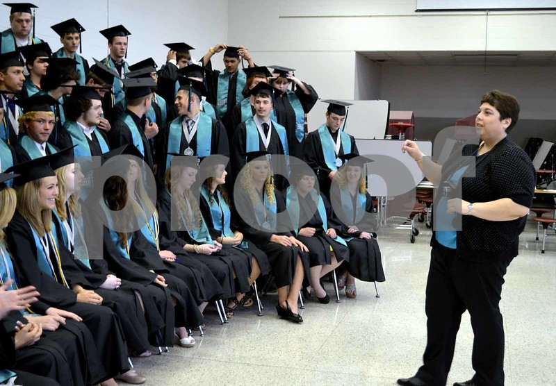 -Messenger photo by Brandon L. Summers<br /> <br /> Sherry Vogel, Southeast Valley High School instructor, gets the graduating class of 2015 ready for their class photo Sunday.