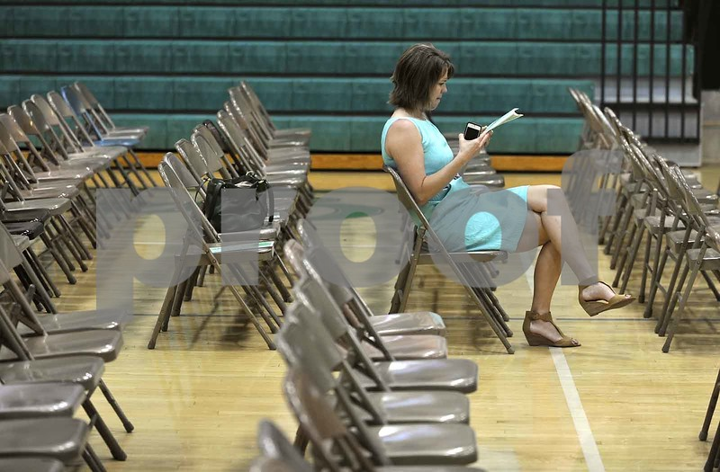 -Messenger photo by Hans Madsen<br /> <br /> Amy Johnson, of Fort Dodge, got herself a good seat for the 60th annual St. Edmond Catholic High School Commencement by arriving nearly an hour early. Her daughter, Emily Johnson, was among the graduates..