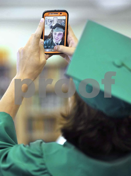 -Messenger photo by Hans Madsen<br /> <br /> Zach Gailey captures an image of himself Sunday afternoon while waiting for the 60th annual St. Edmond Catholic High School Commencement to get started.