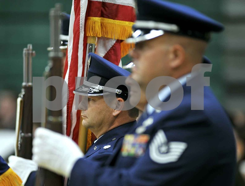 -Messenger photo by Hans Madsen<br /> <br /> Air Force Lt. Col. Justin Faiferlick stands at attention during the presentation by members of the 133rd Test Squadron Sunday at the 60th annual St. Edmond Catholic High School Commencement. Faiferlick's son, Michael Faiferlick, was among the graduates. Faiferlick was able to present his son with his diploma.