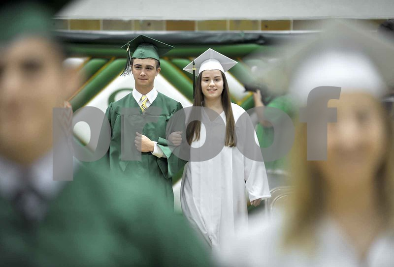 -Messenger photo by Hans Madsen<br /> <br /> John Eide, left, and Jill Salinas march in the gym Sunday afternoon as the 60th annual St. Edmond Catholic High School Commencement gets under way.