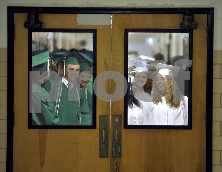 -Messenger photo by Hans Madsen<br /> <br /> The St. Edmond High School class of 2015 lines up in the hall all ready to march into the gym Sunday afternoon for the 60th annual St. Edmond Catholic Commencement. Some of the class includes Michael faiferlick, left, Jade Myers and Breann Wertz.