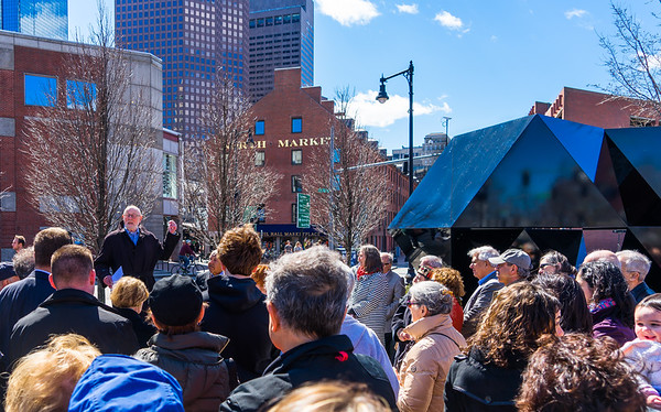 Crowd gathers around Abstract Sculpture as Donald Tellalian speaks