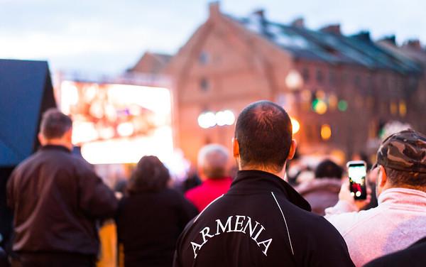 Man wears Armenia jacket at the evening vigil