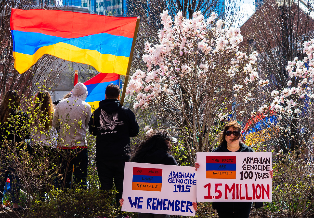 Signs and flags at Armenian Genocide Centennial Commemoration