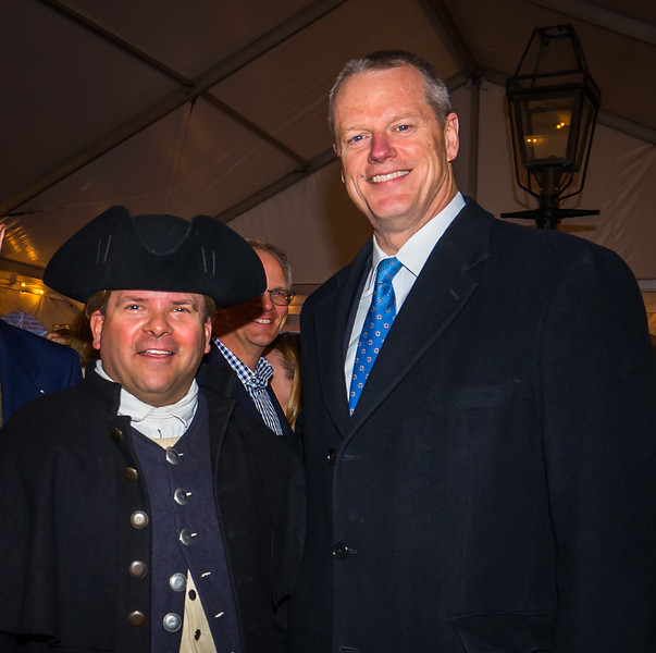 Mass. Governor Charlie Baker (right) celebrates Patriot's Day with Paul Revere re-enactor Michael LePage