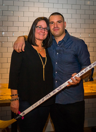 Jaclyn and Matthew with signed Bruins hockey stick