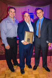 Matt Conti (center) accepts Neighbor of the Year award from Kenny Palazzolo and Louis Strazzullo