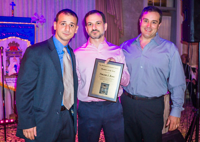 Vincent J. Bono accepts Member of the Year award from Louis Strazzullo and Kenny Palazzolo
