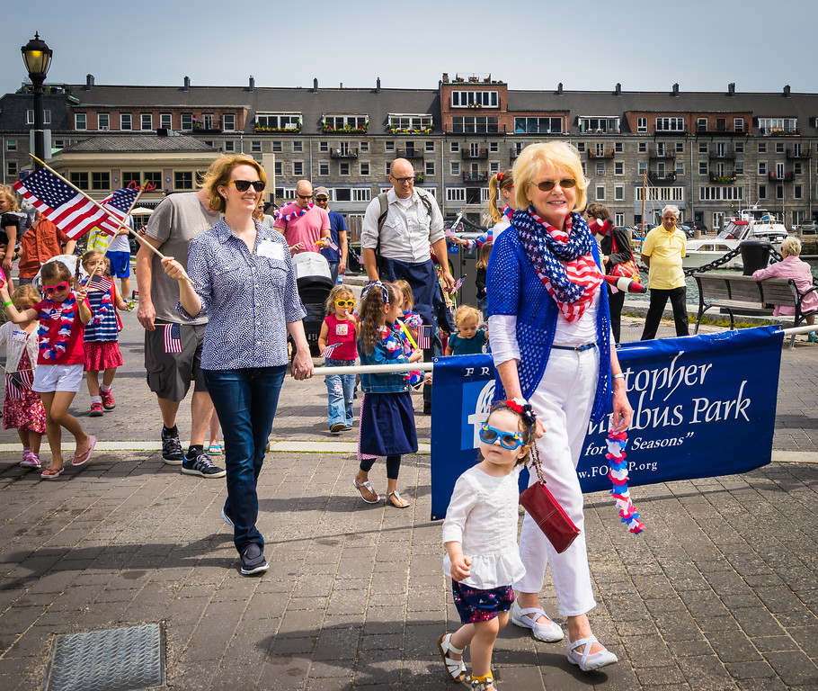Joanne Hayes-Rines leads the parade with her granddaughter
