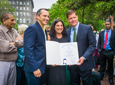 State Rep. Aaron Michlewitz and Mayor Marty Walsh present recognition award to longtime North End coordinator Nicole Leo
