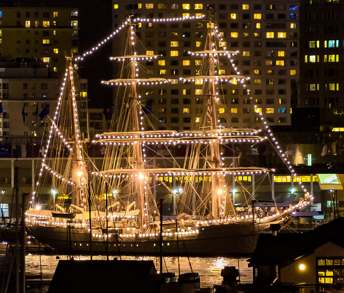 The Sagres, a Portuguese tall ship, lights up Boston Harbor from Fan Pier