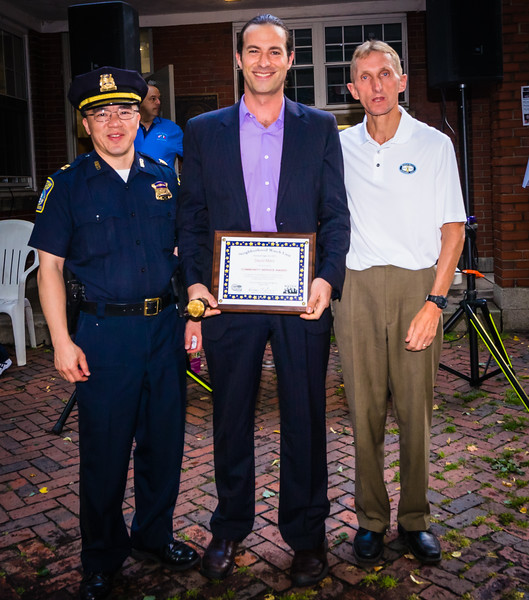 BPD Captain Fong (left) and BPD Commissioner Evans (right) present Community Service Award to David Marx