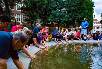 Candle ceremony at North End National Night Out in the Prado fountain