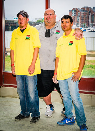 John Puccio of Fleet Fruit with Yellow Team players Bob Cresta and Eric Symes
