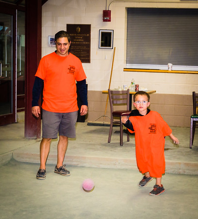 Robert Jr. takes a throw with his father Robert Sacchetti