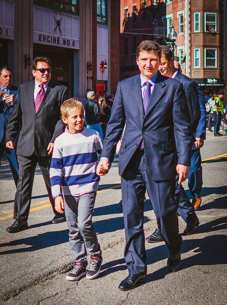 Italian Consul General Nicola De Santis and his son march