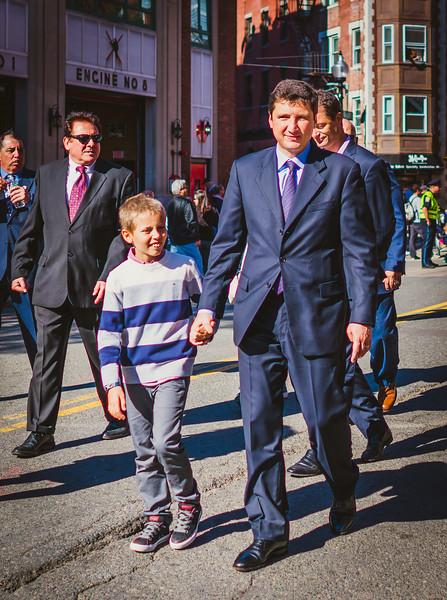 Italian Consul General Nicola De Santis and his son march